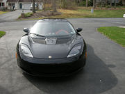 2010 Lotus Evora with red interior.